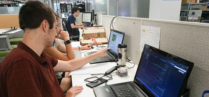 Interns Collaborating at the Lab