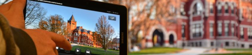 iPad in the foreground with UNH's Thompson Hall in the background