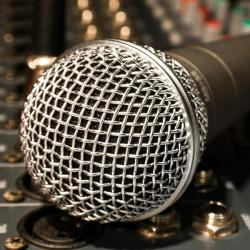 Closeup of a microphone on a mixing board